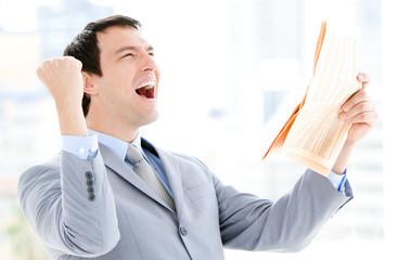 Portrait of a successful businessman reading a newspaper