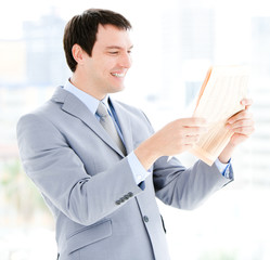 Portrait of a relaxed businessman reading a newspaper