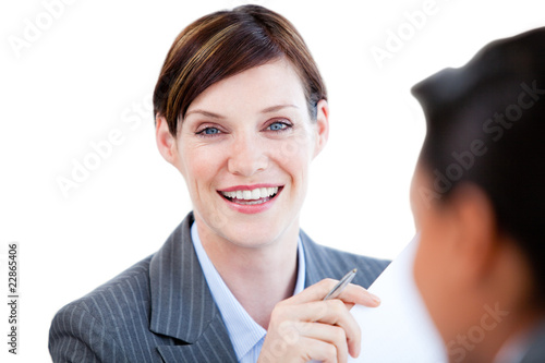 Portrait of a caucasian businesswoman talking with her colleague