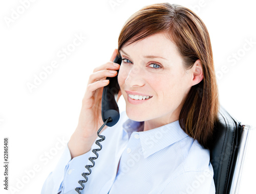 Portrait of a caucasian  businesswoman answering the phone