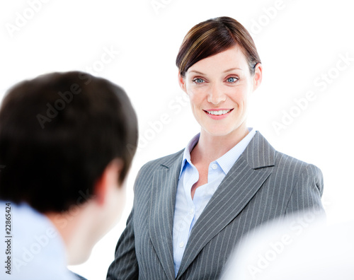 Portrait of a confident businesswoman talking at her colleague d