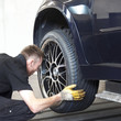 Motor mechanic is changing a tyre