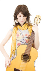 Beautiful woman with guitar - isolated on white