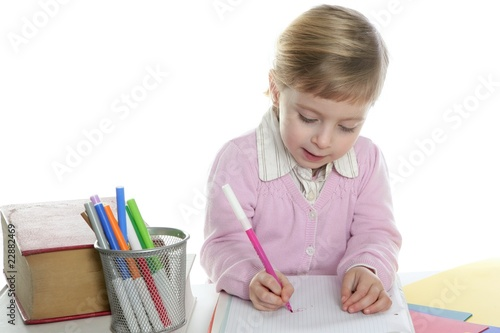 blond little student girl writing desk