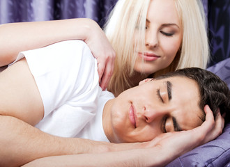Couple bed sleeping awake