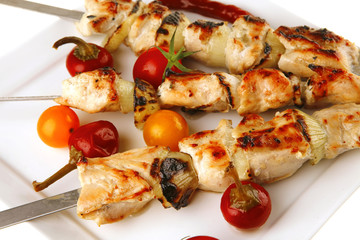 roasted chicken kebab on white