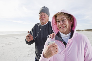 Senior couple listening to music on MP3 player