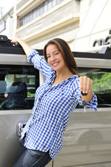 rich woman showing keys of her new bulletproof car