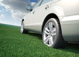 Car standing in a field of grass - ecological transport concept poster