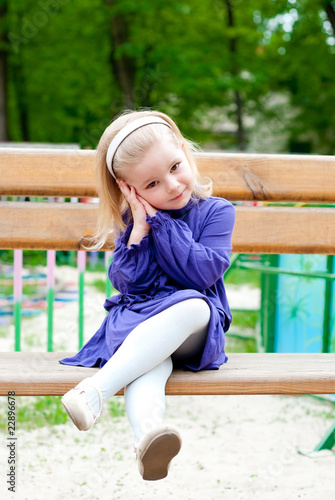 Small girl on a bench