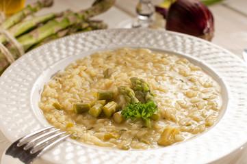 asparagus rice with fork on dish-riso agli asparagi