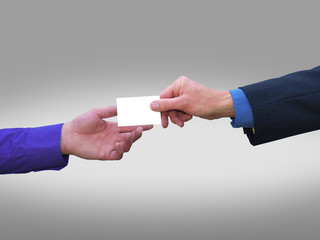 Businessman handing blank business card to another businessman