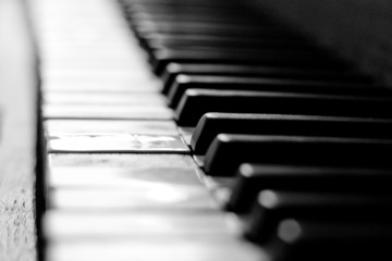 Piano keyboard close-up in black and white