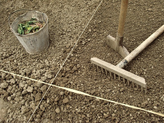 gardening tools on the ploughed ground