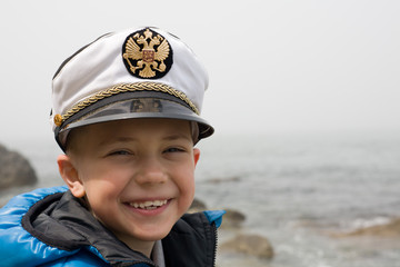 Little ship boy. Sea. Six years. Cap emblem Russia