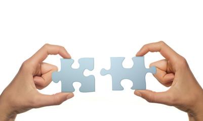 Teamspirit (Puzzleteile zusammenfügen, weißer Hintergrund)