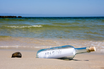 Help message in a bottle on shore
