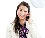 Portrait of a confident businesswoman talking on phone