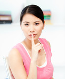 Asian businesswoman asking for silence in the office