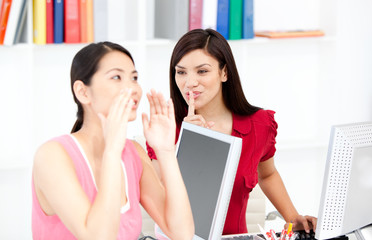 Young businesswoman asking for silence while her colleague shout