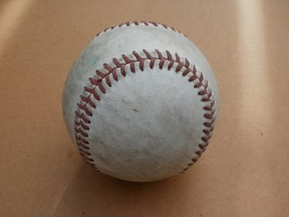 Old, well-worn baseball (hardball)