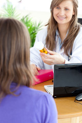Cute female doctor holding medicine