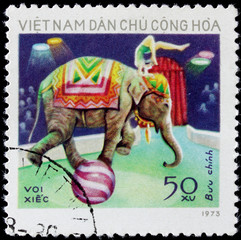 post stamp shows people on elephant in circus