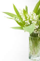 Lily-of-the-valley bouquet in glass transparent vase