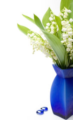 Lily-of-the-valley bouquet in blue vase with glass pebble
