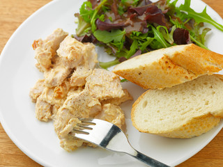 Coronation Chicken with salad and bread