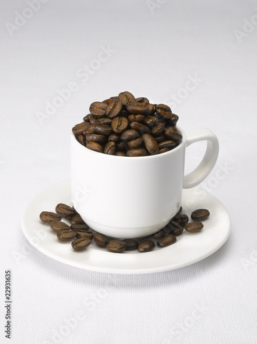 Cup and saucer with coffee beans