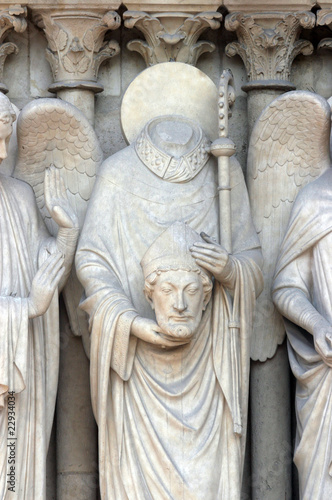 Saint Denis holding his head, Notre Dame Cathedral, Paris