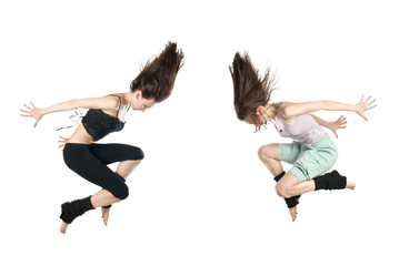 jumping young dancers isolated on white background