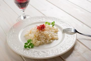 saffron rice on dish - riso allo zafferano