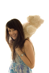 Prettty woman with a teddy on the neck
