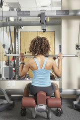 Woman doing seated exercises at the gym