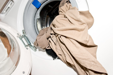 open washing machine with laundry