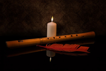 Still Life with flute, candle and red feather