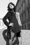 Beautiful italian woman on the embankment poster