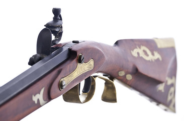 Close up view of the flint lock mechanisim on a replica rifle