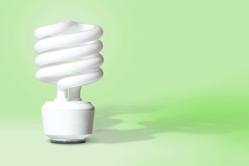 CFL Light Bulb on Green Background