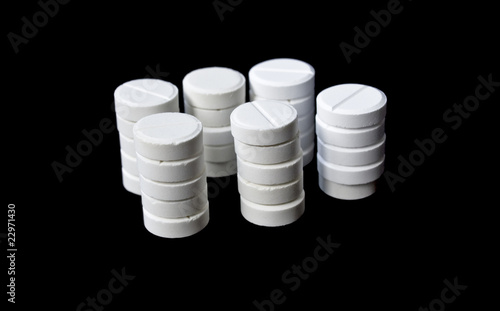 Columns of white pills isolated on black