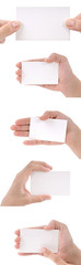 Woman hand holding five blank business cards isolated