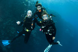 three friends scuba diving together