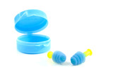 ear plugs and box over white background