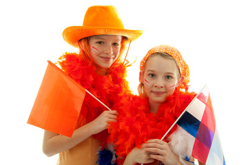 Two girls posing in orange outfit over white background