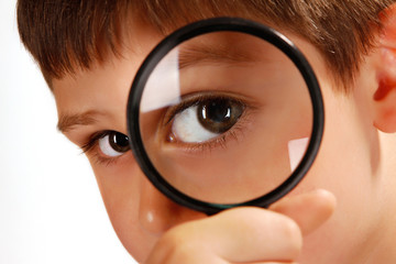 green eyes through magnifying glass