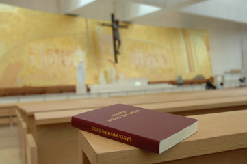 Inside image of a church with a religious book