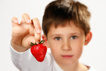 boy holding strawberry