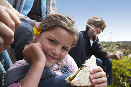 Cute girl eating a sandwich